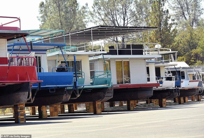 Houseboats sit on blocks to escape being marooned in a depleted Lake Oroville in Oroville, California on September 5, 2021