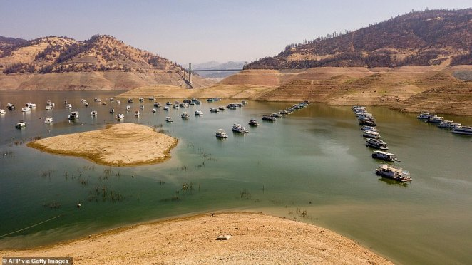 Houseboats sit in a depleted Lake Oroville in Oroville, California on September 5, 2021