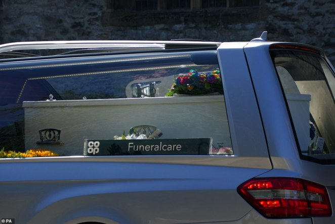 The cortege leaves the Church of St Andrews today following the funeral of three-year-old Sophie Martyn and her father