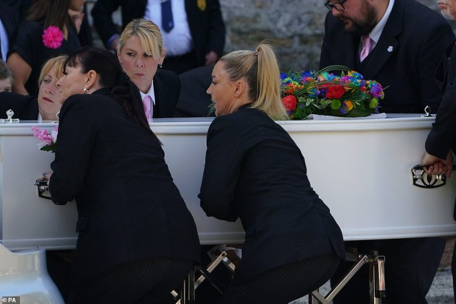 The cortege leaves the Church of St Andrews in Plymouth today following the funeral of Sophie and her father Mr Martyn