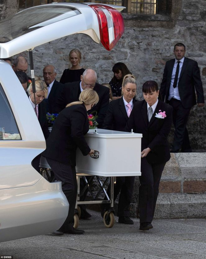 Pall bearers carry the single coffin containing Lee Martyn, 43, and his three-year-old daughter Sophie this morning