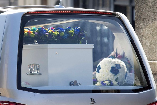 The coffin is pictured today outside the church where the funeral was held for two of the Plymouth shooting victims