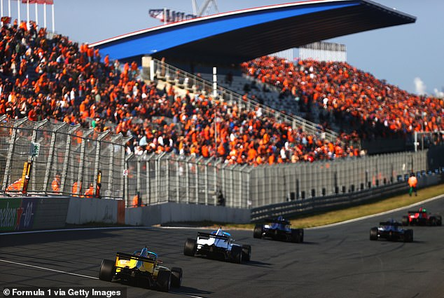 A sea of orange greets the W Series drivers as they race around the track at Zandvoort