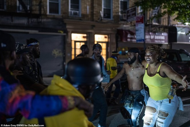 Revelers enjoy themselves on the streets of Brooklyn for J'Ouvert before dawn on Monday