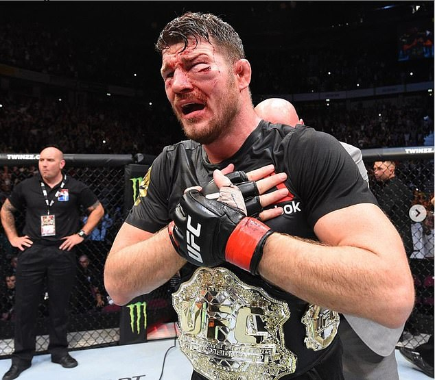 Till posted this picture of Michael Bisping winning his middleweight championship