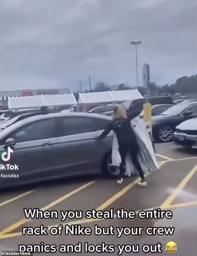 She frantically tries to open the door of her getaway driver's car, but he seems unable to do unlock it
