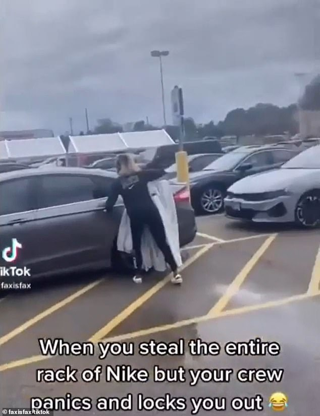 A woman was caught on video trying to steal an entire rack of pants at a sporting goods store in Illinois on Saturday