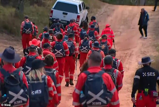 SES search crews (pictured) spent the weekend searching the area for the boy before he was found by a rescue helicopter on Monday