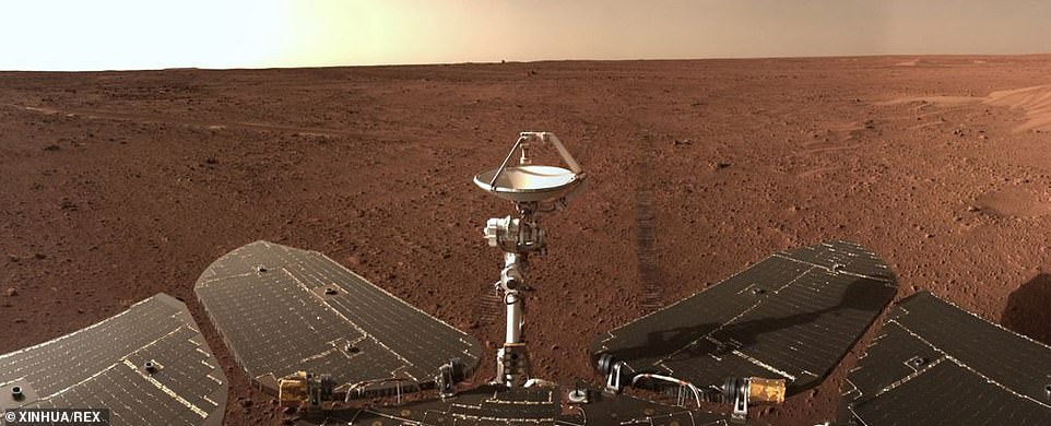 Eagle-eye viewers will notice a small dot above the tip of Zhurong's antenna in the distance, which is the remnants of its landing gear