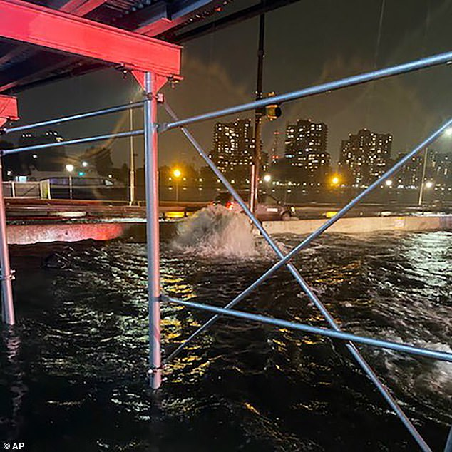 A photo from the New York Police Department shows unprecedented flooding on the Upper East Side of Manhattan on Wednesday