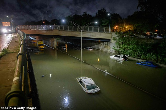 The highway was completely flooded, with cars stalled on both sides of the road