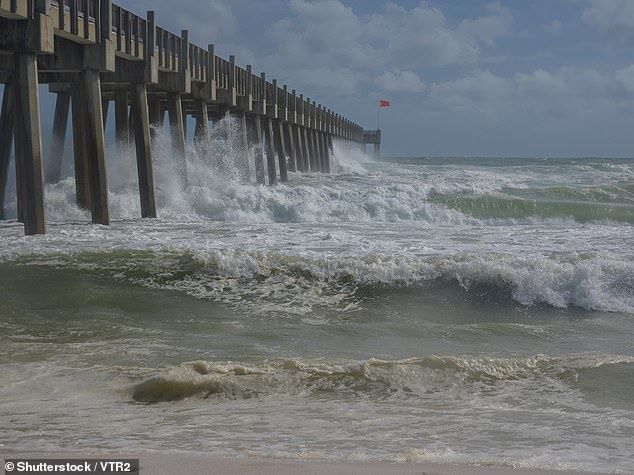 The coastal effects of the storm are expected to persist until the end of the week. Pictured is a coastal storm surge from Hurricane Michael in 2018