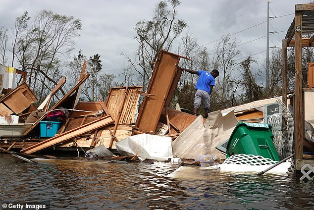 Ida slammed into Louisiana on August 29 as a Category 4 hurricane with sustained winds of 150 mph. The latest death toll in the southern state rose to at least 13 people on Sunday. Pictured is debris in LaPlace, Louisiana on August 30