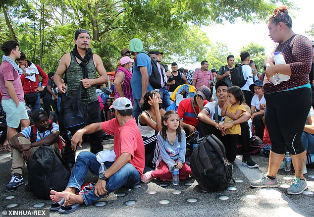 Migrants part of a caravan take a break en route to the United States. Under a potential revamped Remain in Mexico policy, a small number of asylum-seekers would be forced to wait on the southern side of the border