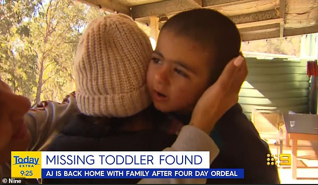 Anthony 'AJ' Elfalak with his mother back at the family property after his three-day ordeal