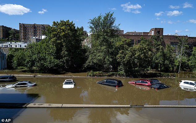 Cars in the Bronx, New York City, were submerged on Thursday morning after heavy winds and strong rains brought by Hurricane Ida