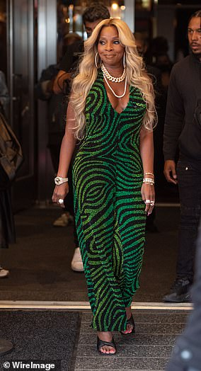 R&B star Mary J. Blige defied her 50 years revealing toned biceps in the emerald jumpsuit she wore to an awards ceremony