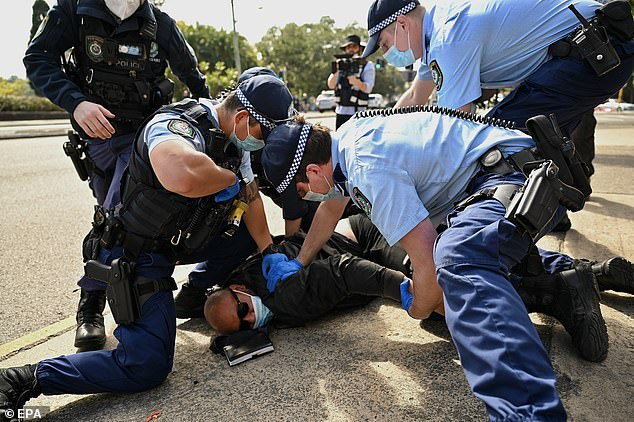 The decision was prompted by the force's role on the frontline of the state's pandemic response, the force said. Pictured is a protester being arrested at the'National Rally for Peace, Freedom and Human Rights' anti-lockdown protest in Sydney on August 21