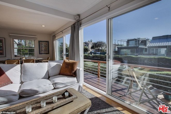 The light and airy property boasts features floor-to-ceiling windows and a large sun-drenched living room
