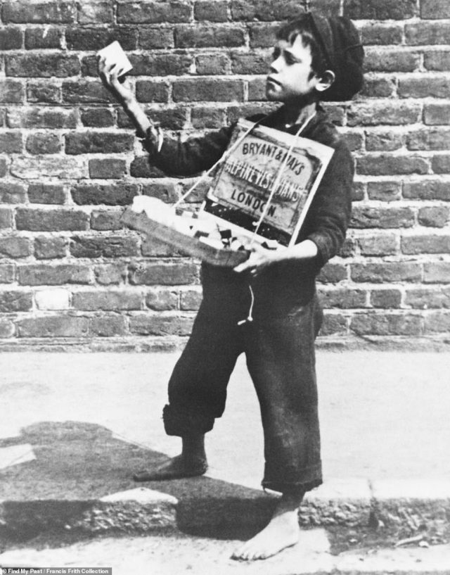 Another image, taken in Greenwich, south-east London, in 1884, shows a small barefoot boy selling 'Bryant & May' matches. Dressed in a black cap, top and rolled up, fraying trousers, the child is seen holding out in front of him a box of matches from the brand, which still exists today. The photo is one of more than 300,000 images taken in cities, towns and villages up and down the country during the 19th and 20th century which are newly-available on ancestry website Findmypast