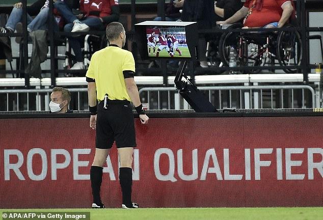 Referee Georgi Kabakov checked his VAR monitor to watch replays of the foul on Adams