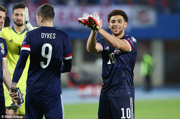 Che Adams (right) played a superb supporting role to Dykes in Scotland's attack