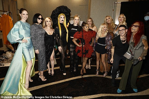 Christine posed backstage with Christian and his many muses - (from L-R) Coco Rocha, Leigh Lezark, Slayyyter, Leah McSweeney, Aquaria, Leah McSweeney, Lil' Kim, Alicia Silverstone, Kristin Chenoweth, Busy Philipps, and Patricia Field