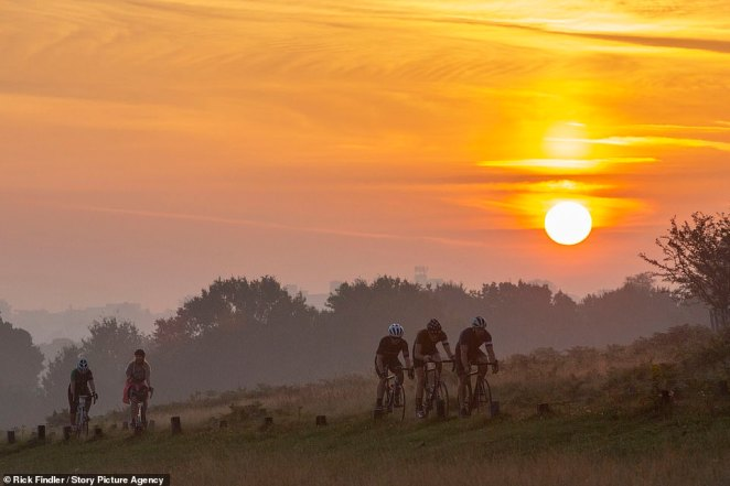 Central, eastern and northern parts of England are expected to remain dry throughout Wednesday, with central England in particular expected to bake in near record-breaking September sun. Above: Cyclists pictured in Richmond Park, Wednesday