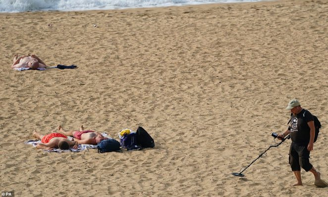 Sunseekers at Bournemouth Beach, Dorset set up to enjoy the last blast of September sun before thunderstorms and heavy downpours look set to ravage large parts of Britain later this week