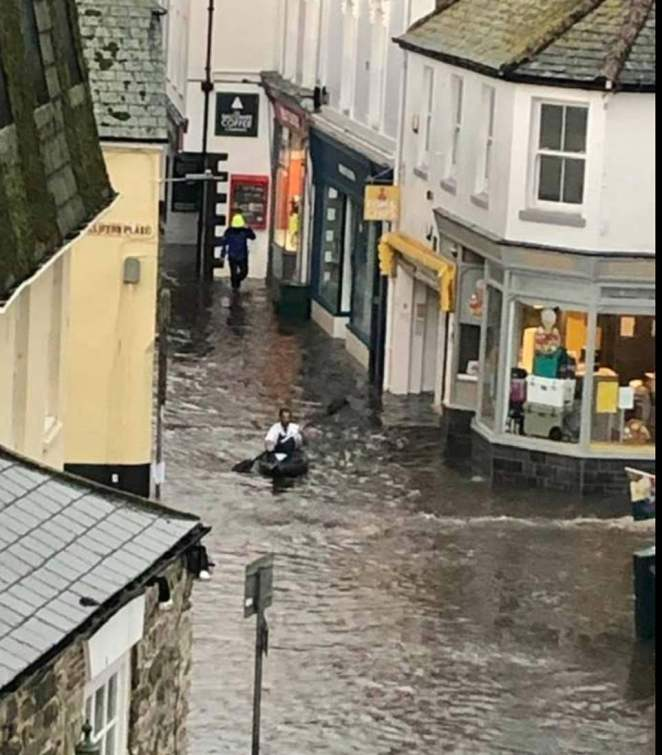 In south Devon, a crafty kayaker has been pictured paddling down a flooded street in Salcombe after the coastal town was battered by flash floods and power cuts