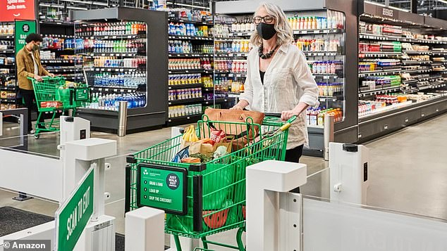 Cameras and sensors track what's taken off shelves and items are charged to an Amazon account after customers leave the store with them. Pictured: An Amazon Fresh grocery store