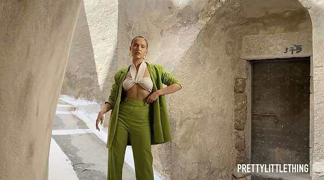 Work it: In one image she modelled a chic green suit and cream crop top