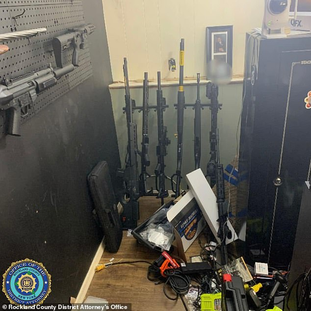 Authorities found more weapons on a rack located against another wall in what court documents referred to as his 'gun room'
