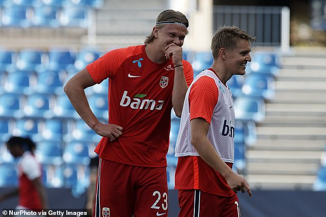 His Norway team-mate Martin Odegaard (R) called his international record 'absolutely insane'