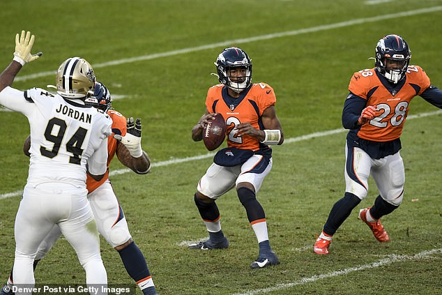 The Denver Broncos lost 31-3 to the visiting New Orleans Saints with practice squad wide receiver Kendall Hinton (center) filling in at quarterback