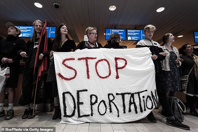 The Social Democratic government stated in the proposal, 'if you come to Denmark, you have to work and support yourself and your family' (pictured, refugee activists protest against deportations at Copenhagen Airport in 2016)