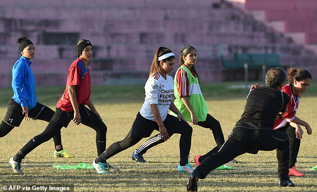The Afghan women's football team limbering up for a fixture in Pakistan in November, 2014