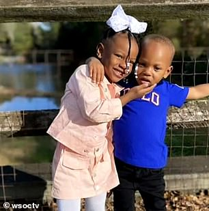 PICTURED: Asiah Fiquero, 3, (right) with his older sister (left). Asiah was shot around 11:45 p.m. Tuesday night, along Richard Rozzelle Drive near Mountain Island Lake, in what police believe to be a targeted shooting