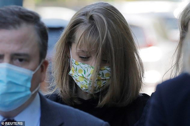 Smallville actress Alison Mack (pictured at her sentencing in June) was jailed for three years