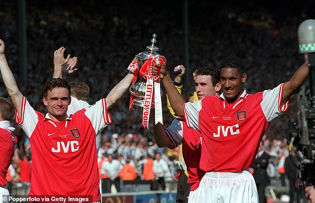 Dutchman Overmars (left) helped the Gunners secure a league and cup double in 1998