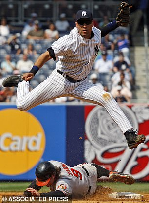 Jeterleaps over Baltimore Orioles' Gregg Zaun as he turns an inning-ending double play on a ground ball hit by Felix Pie in the eighth inning of the Yankees 6-4 victory over the Baltimore Orioles in their baseball game at Yankee Stadium Wednesday, July 22, 2009