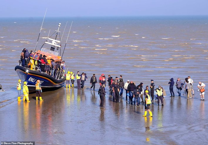 Migrants in Kent after making the journey yesterday amid a growing row between Priti Patel and France over the crossings