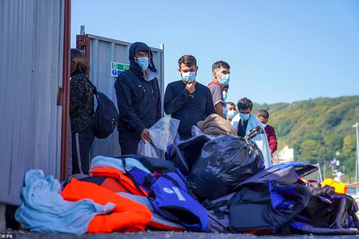 A group of people thought to be migrants are brought in to Dover, Kent, following a small boat incident in the Channel on September 8
