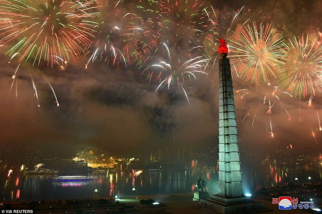 Fireworks lit up the sky above Pyongyang during the elaborate parade, which experts say was intended to signal a focus on domestic issues