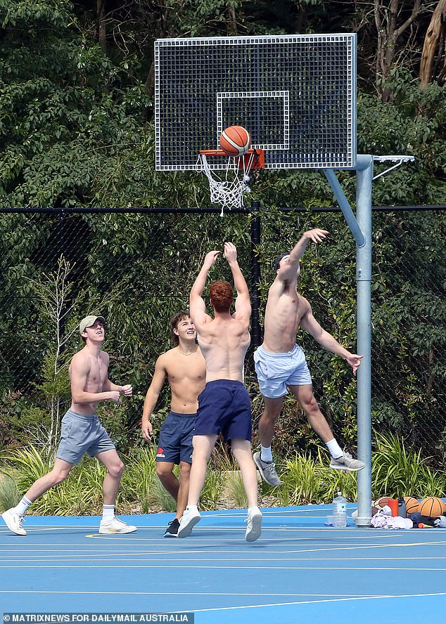 Locals hit the b-ball court to get in a quick game of hoops (pictured) on Thursday as temperatures topped 28C in Sydney