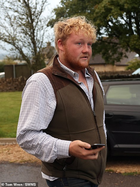 Kaleb Cooper arrives at the town hall meeting called to discuss his farm shop