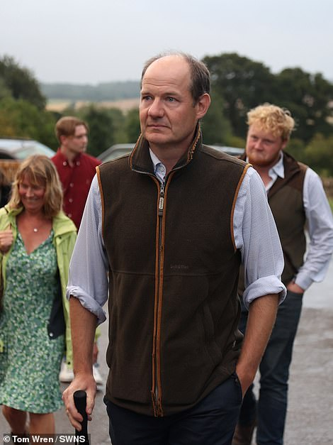 Charlie Ireland arrives at the town hall meeting called to discuss his farm shop