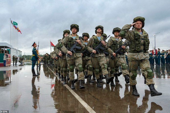 Russia has said the massive drills are purely defensive in nature and will give Moscow and Minsk a chance to improve the way their respective militaries work together (pictured, Russian troops parade ahead of the war games on Thursday)