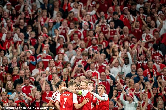 Pictured: Thousands of maskless Denmark football fans cheer on their national team on Tuesday in Copenhagen for a world cup qualifier match against Israel.On Saturday, a sold-out concert in Copenhagen will welcome 50,000 people, a first in Europe