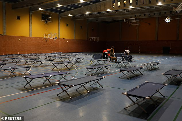 Around 100 residents were put up in a nearby sports hall after they were evacuated from their homes as wildfires threatened the settlements